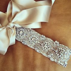 This rhinestone and pearl wedding sash is vintage inspired with a modern twist. We call it OHIO and the sash tends to work with most