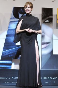 Pin for Later: 52 Reasons to Celebrate Angelina Jolie's Red Carpet Evolution Angelina Jolie's Red Carpet Transformation For the 2010 Japan premiere of Salt, Angelina wore an Atelier Versace Fall 2000 black chiffon high-neck gown with a thigh-high slit and open back.