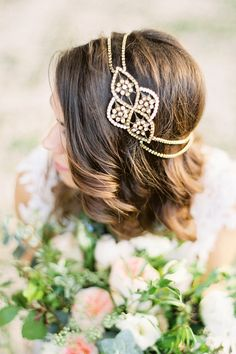 Gorgeous bronze statement crystal headpiece is adorned with tiny ivory pearls and wraps around your hair like a halo that has double crystal chains.
