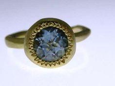 CATHERINE BOWMAN Pledge ring:18ct yellow gold set with Aquamarine.