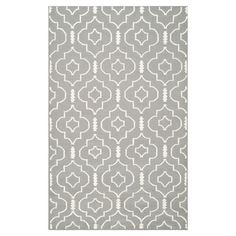 Anchor your living room decor or define a space in your master suite with this hand-woven wool and cotton rug, showcasing a quatrefoil motif in grey and ivor...