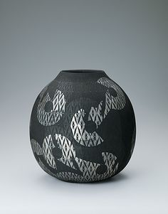 View the Details of Vessel with matte black glaze and geometrical design over diamond pattern.. Gallery Japan transmits Japan's most beautiful 'traditional art crafts' to the rest of the world.Please check out excellent japanese traditional culture productions(photo) by living national treasures and artists.