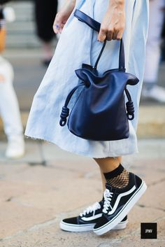Streetstyle of woman wearing Van's sneakers an a Loewe bag during Milan Fashion Week Spring Summer 2017