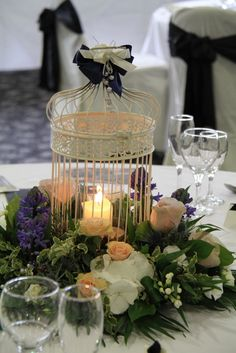 birdcage with candles and flowers