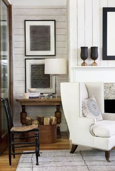 horizontal wood walls with vertical fireplace wall.