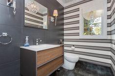 Modern stripes really work in this half bath. #interiordesign #design #decor