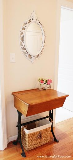 love the use of an old school desk as a hallway table **wonder if i could do something like this with the sewing machine base.