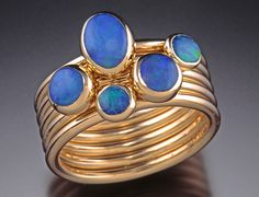 Stacking Lady's Ring by Donald Pekarek. Five 14K gold stacking rings with bezel set solid Australian opals.