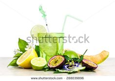 tropical fruits cocktail over white  - stock photo
