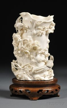 Ivory Brush Pot, China, 19th century, carved in the form of a tree trunk with birds perched atop flowering branches, ht. with stand 9 1/4 in.