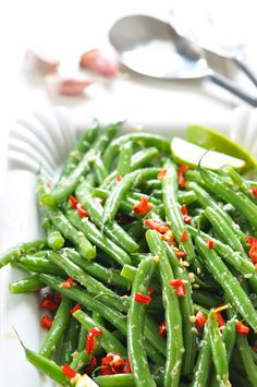 I used this recipe for my first cooking with coconut oil experiment. Wow! Unbelievable flavor + a long list of health benefits and multiple uses. | Garlic Green Beans |