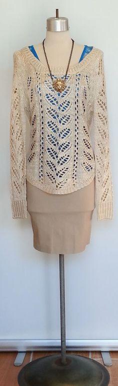 Soft sheer tan sweater with tan pencil skirt.