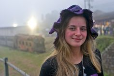 This lovely girl was wearing a very cool witch outfit at the Winter Festival of Paranapiacaba, about 70 km. from Sao Paulo. Paranapiacaba has fog most of the year and that gives the unusual look to her background. The train in the left of hear is an  Ally