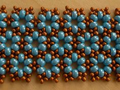 Kisviragas - Turquoise and copper beads using this tutorial: http://img-fotki.yandex.ru/get/6618/101955082.1c/0_afa81_f710bad_XXL.jpg