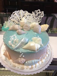 Under the sea birthday cake -- white chocolate drizzeled to make coral?