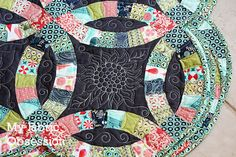 A close up of the awesome quilting on Becky's Double Wedding Ring quilt!