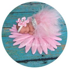 Baby is 2 long and in a non edible feather skirt and diamond accent 2 long 1 fondant daisy base 3 Fondant Cake Toppers, Fondant Baby, Baby Shower Cakes, Baby Shower Themes, Tutu Cakes, Clay Baby, Baby Tutu, Pink Feathers, Sugar Art