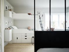 Window room divider for a parent / child shared bedroom. Small space inspiration - from the home of a Swedish stylist. Joanna Bagge /  Jonas Berg. Stadshem.