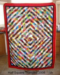 "An interesting HST scrap quilt.  I like this layout.  It doesn't look too ""out there"" and you can make sense of it."