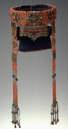 Ordos, Mongolian headdress; padded cotton with coral and turquoise beads.  Asian Art Museum, San Francisco~