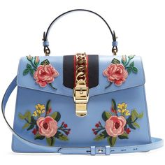 Gucci Sylvie large floral-appliqué leather shoulder bag (€2.715) ❤ liked on Polyvore featuring bags, handbags, shoulder bags, gucci, light blue, gucci shoulder bag, gucci purse, blue leather shoulder bag, floral leather handbags and light blue handbags
