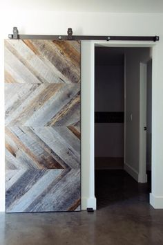 See the beautifully detailed wood sliding barn door in this modern hallway on HGTV.com.