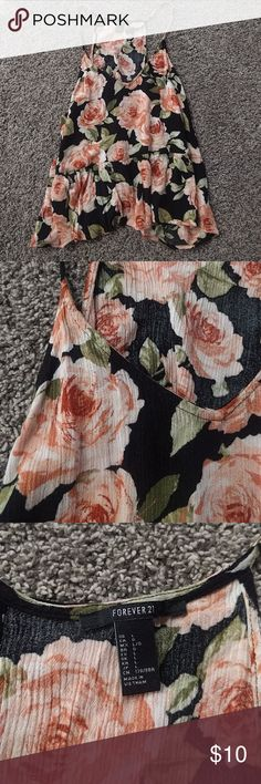 F21 Floral tank Black and pink floral tank. Very flowy. Spaghetti straps. Size L but fits M. Perfect condition. Forever 21 Tops Tank Tops