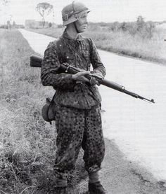 """A young Grenadier of the 12th SS-Panzer-Division """"Hitlerjugend"""" somewhere in Normandy/France, July 1944. In the years 1943/44 the average age of the Waffen-SS trooper was 18/19 years."""
