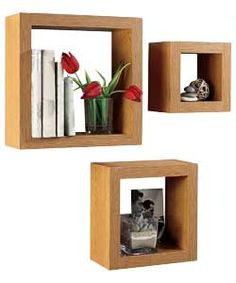 This is a set of 3 chunky cube shelves frame and display your possessions. Perfect for any lounge, dining room or hallway as a stylish storage solution.