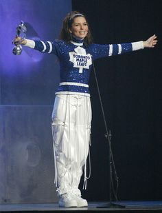 Shania Twain, Toronto Maple Leafs. (Admittedly, you can find pics of her performing in team jerseys from almost every city, country, and sport in existence. But still.)