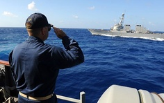 Cmdr. Vince Baker renders honors to the ship USS Mitscher (DDG-57).