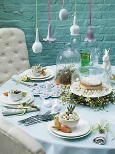 Easter Creatures. The bluebells here grow upside down. Faux florals weave around glorious cake stands. Bunnies of all shapes and sizes decorate tables. Bell jars and cups display colourful eggs. Some of these eggs are edible, and what's more, chocolate