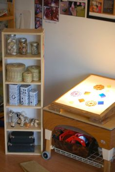 Shelf  next to light table at the Acorn School