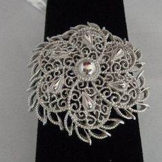 Trifari Silvertone Filigree Sheild Brooch now for sale at $22.00 see more pics on www.CCCsVintageJewelry.com Gorgeous Silvertone Filigree Brooch with center silvertone ball. There are many options for shipping.  This is a new listing but is under the sale section because all of the items in our store are on sale. The Best Vintage Jewelry Sale Ever is going on.  Hope to see you there. Coco