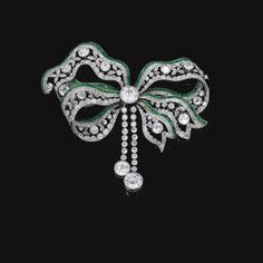 A Belle Epoque emerald and diamond brooch, circa Designed as a tied ribbon, millegrain set with circular-cut diamonds, accented with lines of carré-cut emeralds, detachable brooch pin to reverse. Bow Jewelry, Emerald Jewelry, Art Deco Jewelry, High Jewelry, Jewelery, Jewelry Accessories, Jewelry Design, Jewelry Stores, Jewellery Shops