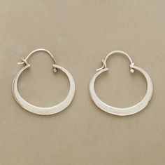 """WHAT GOES AROUND COMES AROUND EARRINGS -- Recycled sterling silver starts life anew as an oval hoop to adorn the ear. Snap down wires. Sundance exclusive handmade in USA. 7/8""""L."""