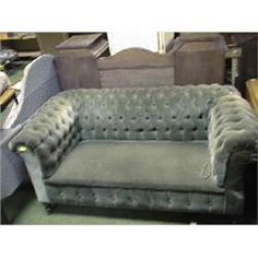 A Victorian 2 seater chesterfield drop-arm sofa with green button dralon upholstery and having t