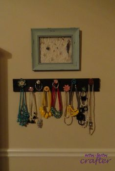 Necklace and earring organizer that I can hang out of reach from my toddler.