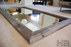 DIY reclaimed wood floor mirror made from a giant bathroom mirror - doing this!!!