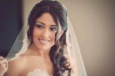 Love the long loose curls and the veil