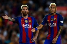Lionel Messi (L) and Neymar Jr. of FC Barcelona react during the La Liga match…