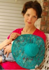 This breastfeeding hat for baby is such a great idea for moms who like to cover up when nursing... especially in summer when blanket covers are too hot.