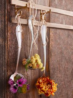 Decorate the wall space above a buffet or sideboard with blooms that spill out from serving spoons.
