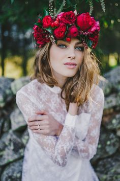 Boho bride wearing red flower crown with relaxed downstyle and natural makeup