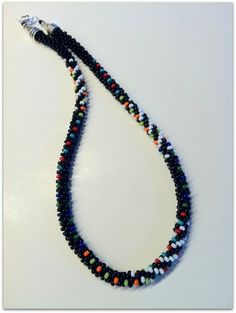 Kumihimo Painting with Beads by Karen Huntoon. I made this necklace for my mom. 8/0 Toho Seed Beads.