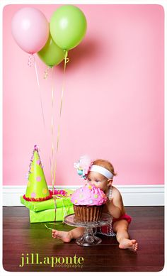 Cute 1st birthday  - I got one of these cupcake cake pans and I LOVE it!! one box of cake mix makes this adorable cake. Jake ate his like this too, we put it on a cake stand and on the floor for him as well, super cute birthday!