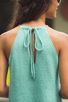 A picot-edge hem, adjustable halter top, and stockinette A-line body comprise Megan Nodecker's Tide Pool Top, a fun halter-neck knitting pattern with a tied neck. The yarn is a blend of wool, cotton, linen, and silk, making it super smooth and cool for summertime.