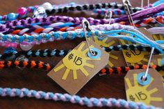 Just had to use Jacque Larsens adorable tags for the prices.   My DD has a market day @ school and she's selling these friendship bracelets. All the kids make something to sell and the other kids and parents buy them. The kids get fake cash from their teacher that they earn for doing the right thing.