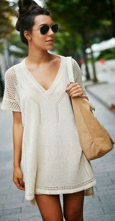 White dress with open chest and handbag
