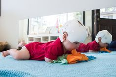 Montessori baby activity -- using play silks with babies can be a fun way to encourage movement and exploration.